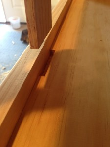 Detail of the notch in the bottom panel that receives the sliding lock.
