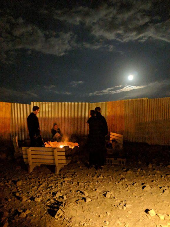 desert capsule hotel concrete tubes israel bonfire