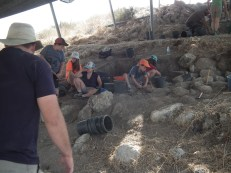 Friday is community day! removing loose debris from the new excavation square in B1