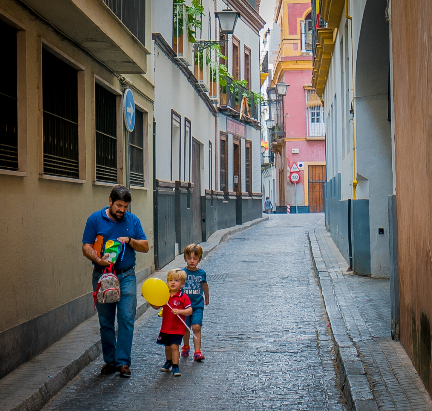 Father with Sons in Seville Alley