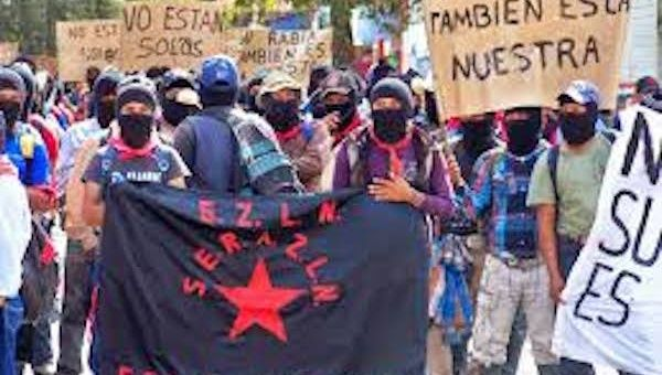 Zapatistas march in support of the disappeared Ayotzinapa students.