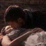 a screepcap of princess aurora and prince phillip sharing true love's kiss
