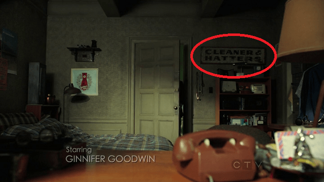 a screepcap of a cleaner & hatters sign in the mystery man's apartment