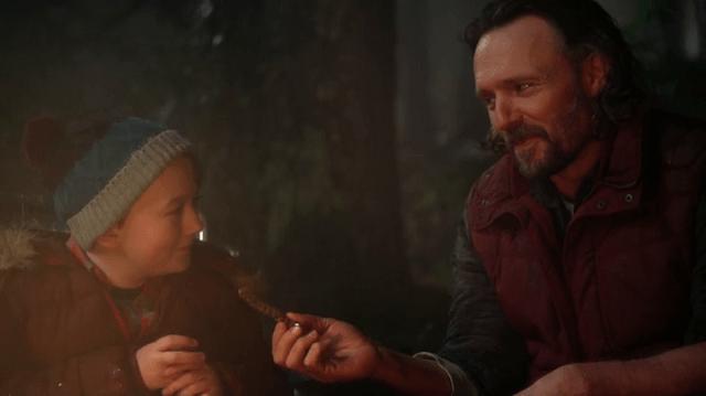 owen flynn (played by benjamin james stockham) and his father, kurt flynn (played by john pyper-ferguson) bond around a campfire