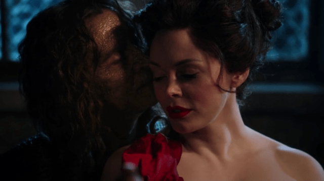 rumpelstiltskin (played by robert carlyle) kissing a young cora (played by rose mcgowan) again