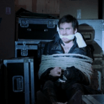 a screencap of captain hook (played by colin o'donoghue) tied up and gagged