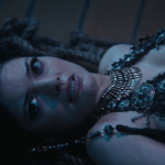 a screencap of an evil mermaid (played by natasha wilson)