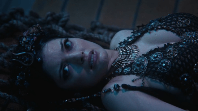 a screencap of an evil mermaid (played by natasha wilson)
