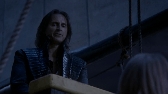 a screencap of rumpelstiltskin (played by robert carlyle) wearing his old enchanted forest clothes