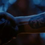 a screencap of the lion tatton on robin hood's arm