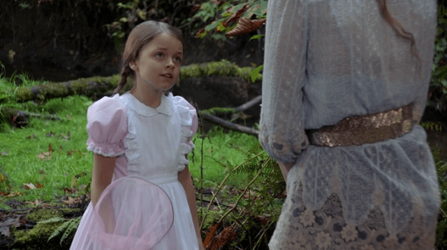 a screencap of alice (played by sopie lowe) meeting her half-sister, millie (played by kylie rogers)