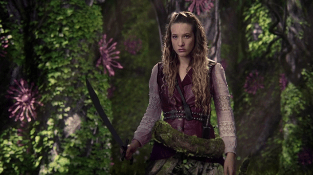 a screencap of alice (played by sophie lowe) turning into a tree