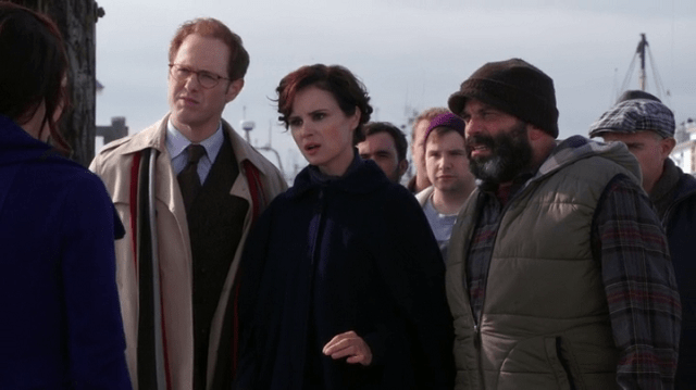 a screencap of belle (played by emilie de ravin) talking to dr hopper (played by raphael sbarge), mother superior (played by keegan connor tracy), leroy (played by lee arenberg)