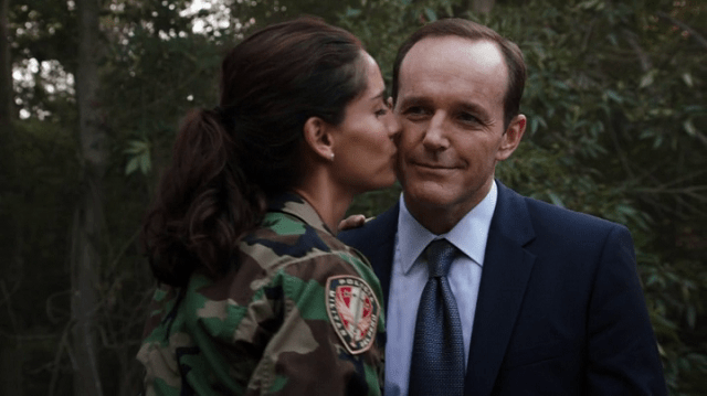 a screencap of camilla (played by leanor varela) kissing agent coulson (playe by clark gregg)