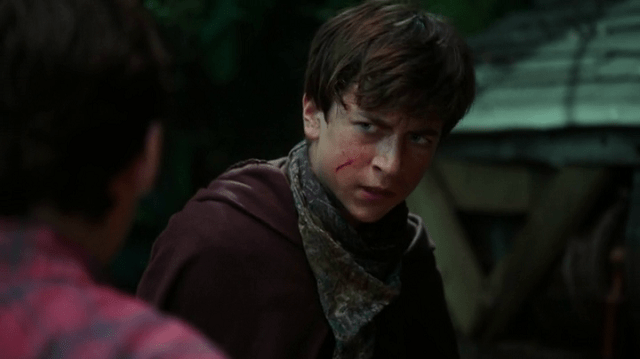 a screencap of devin (played by skyler gisondo) with a cut on his cheek