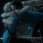 a screencap of neal (played by michael raymond-james) hugging emma (played by jennifer morrison)