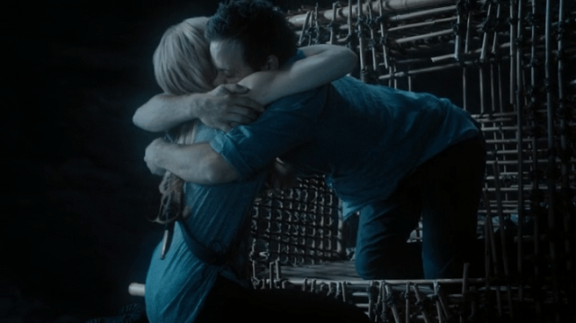 a screencap of neal (played by  michael raymond-james) hugging emma (played by jennifer morrison)