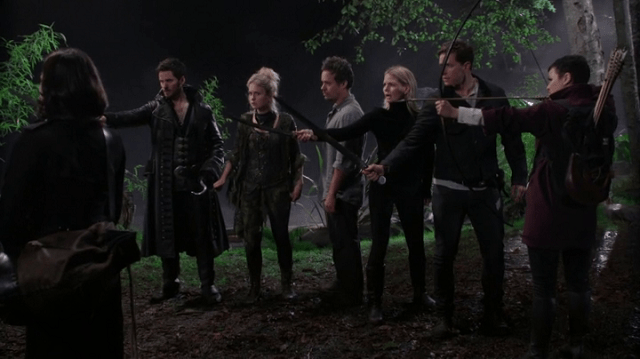 a screencap of everyone pointing their weapons at rumpelstiltskin