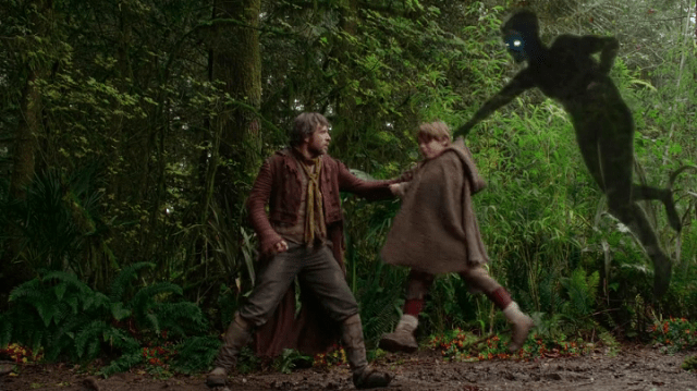 a screencap of rumpelstiltskin's father (played by stephen lord) giving a young rumpelstiltskin (played by wyatt oleff) to the shadow