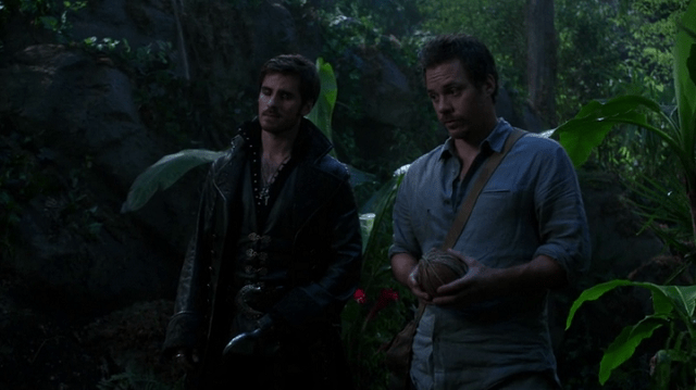 a screencap of captain hook (played by colin o'donoghue) and neal (played by michael raymond-james) and a coconut