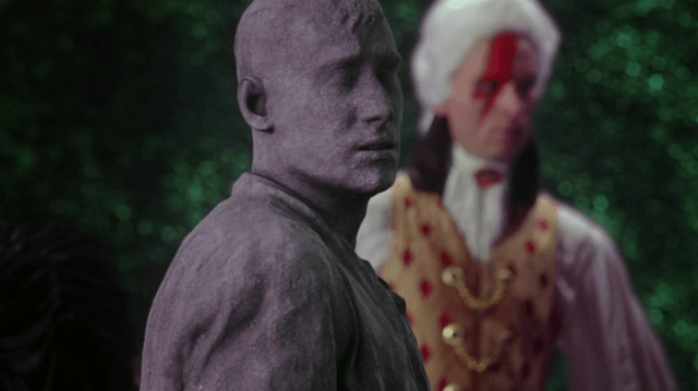 a screencap of the knave of hearts (played by cgi) turned to stone