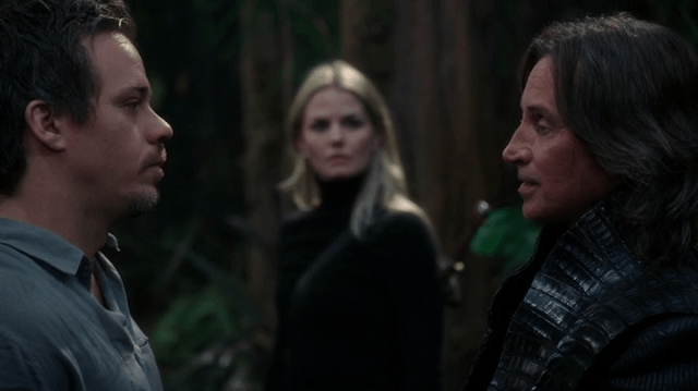 a screencap of neal (played by michael raymond-james) and rumpelstiltskin (played by robert carlyle) facing-off as emma (played by jennifer morrison) looks on