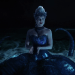 a screencap of regina (played by lana parrilla) transformed into ursula the sea goddess