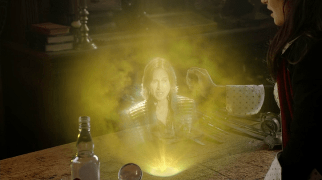 a screencap of rumpelstiltskin (played by robert carlyle) in a magic message to belle