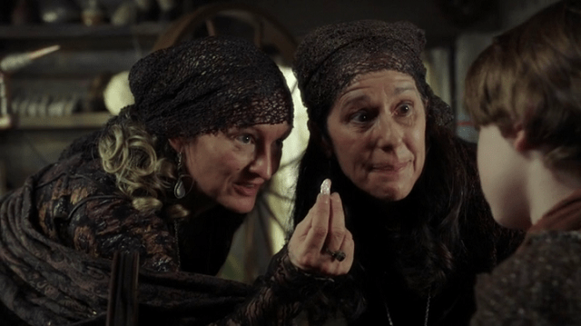 a screencap of the spinsters (played by lindsay collins and glynis davies) offering a magic bean