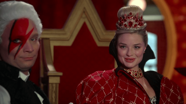 a screencap of a tweedle in ziggy stardust makeup and the red queen (played by emma rigby)