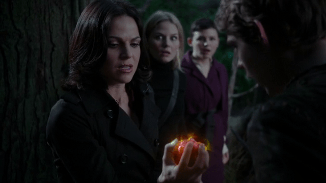 a screencap of regina (played by lana parrilla) retrieving henry's heart from pan while emma (played by jennifer morrison) and snow white (played by ginnifer goodwin) look on shocked