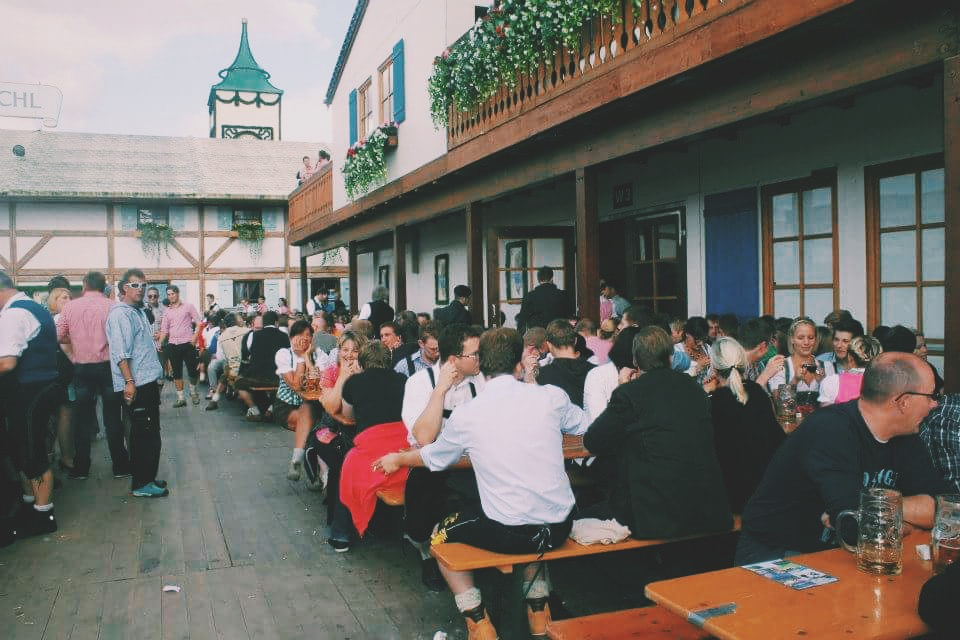 Sitting outside the beer tents at Oktoberfest, Munich, Germany
