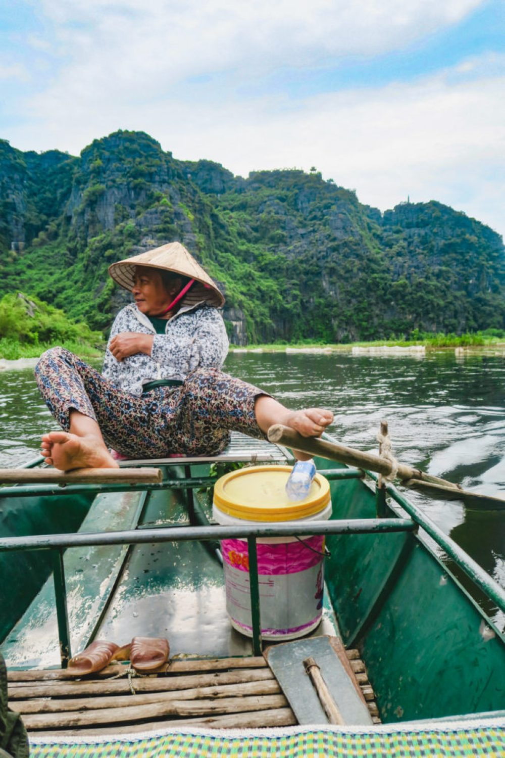 On the Tam Coc boat tour, the rowers are rowing with feet