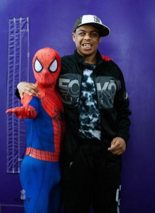 Happy Teen posing with spiderman