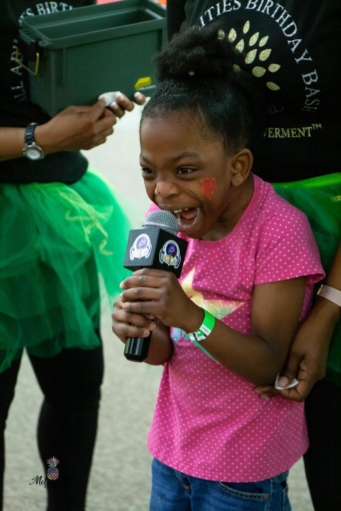 girl excitedly speaking into microphone