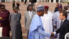Muhammadu Buhari and other government officials welcoming visiting President Emmanuel Macron