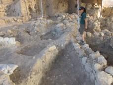 Excavating the EB III alleyway, Area E, 2011