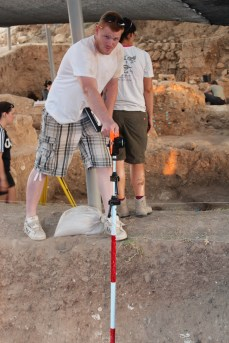 Jeremy Beller taking height measurements Area E 2013