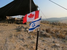 Canadian and American flags over Area E, 2011