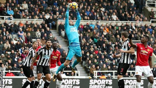 Newcastle goalkeeper Martin Dubravka catches the ball
