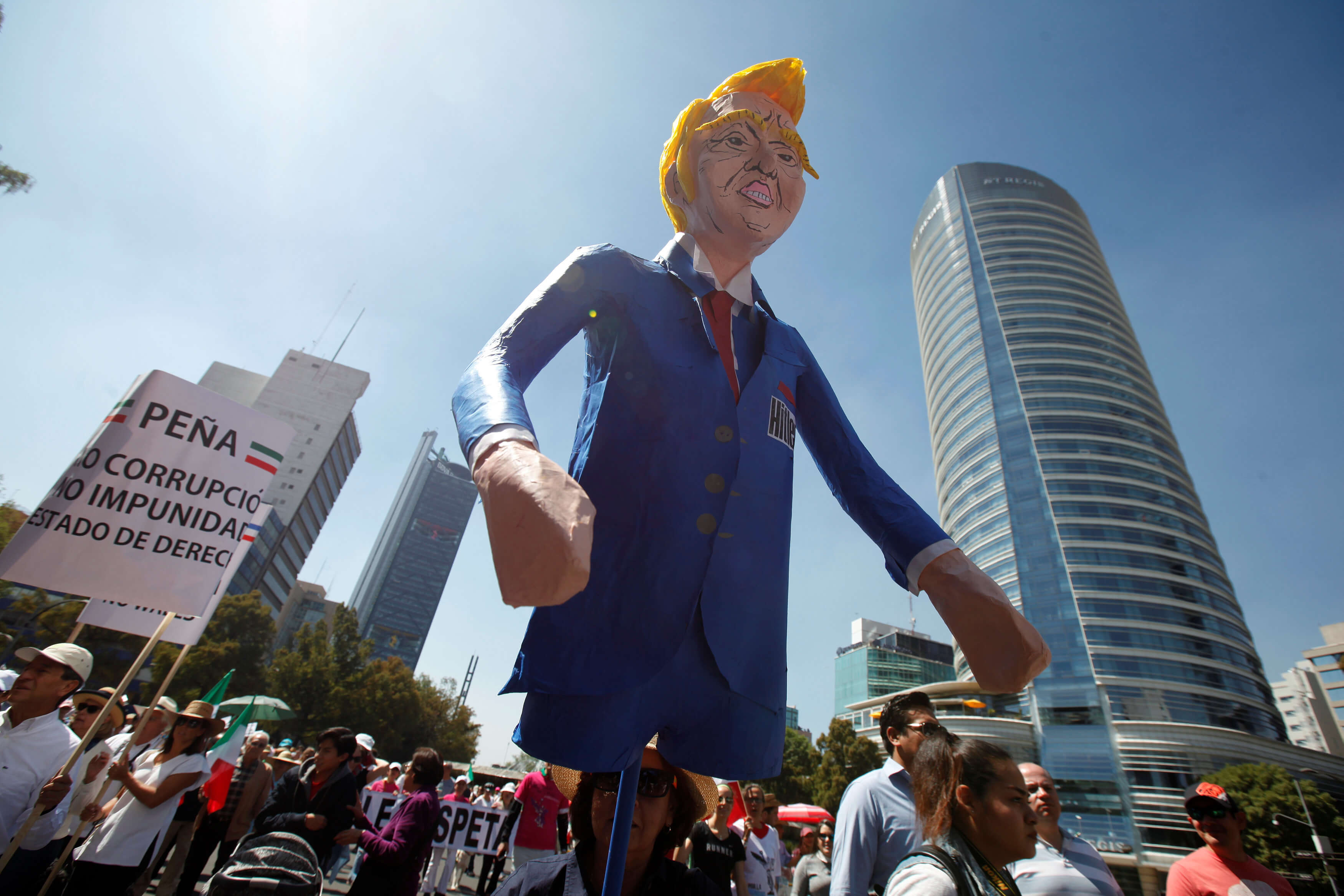 Marchers across Mexico vent anger over Trump, and their own president