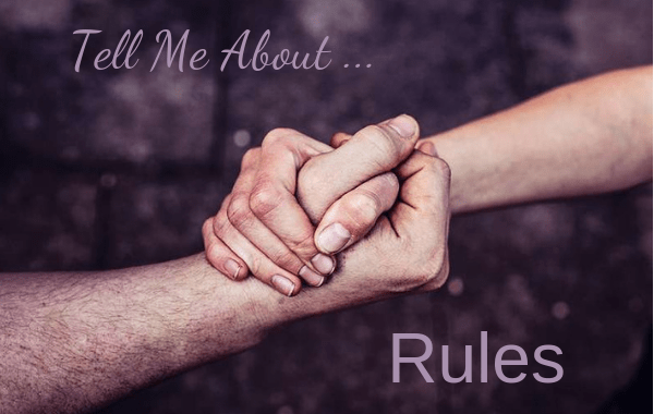 Rules. Tell me About Rules with two hands holding each other