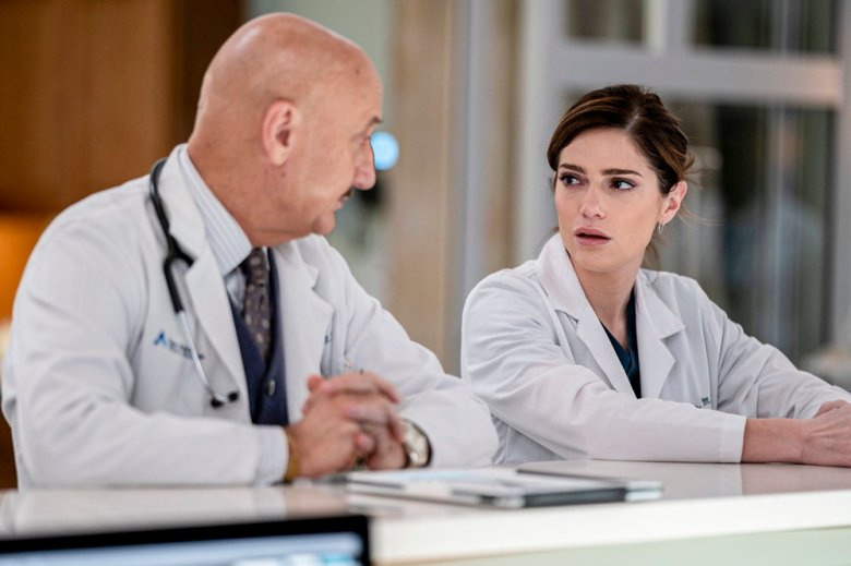 """New Amsterdam Season 2 Episode 14, """"Sabbath"""" Pictured: (l-r) Anupam Kher as  Dr. Vijay Kapoor, Janet Montgomery as Dr. Lauren Bloom 