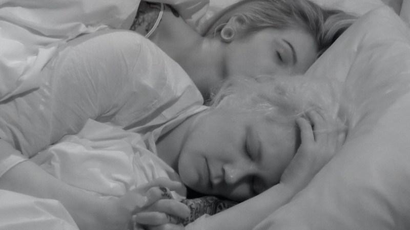 Sarah and Charlotte fall asleep holding hands.