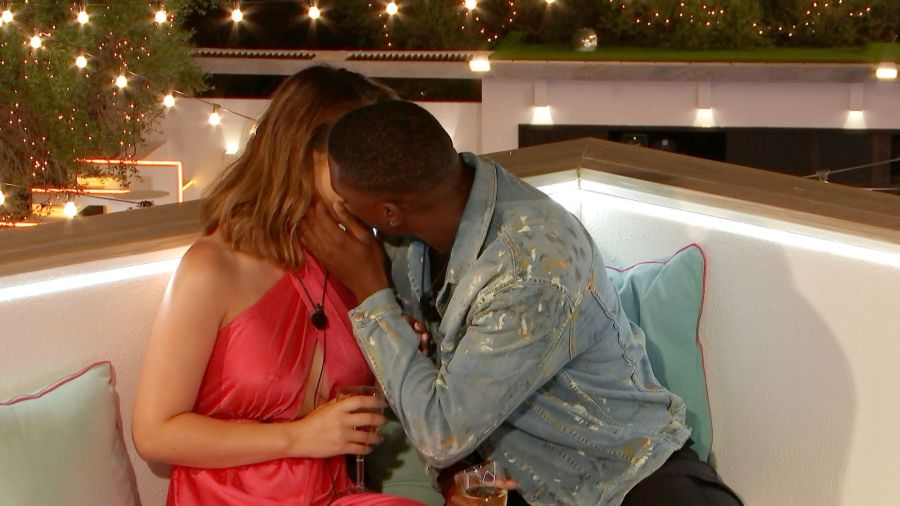 Sharon and Aaron share a kiss.