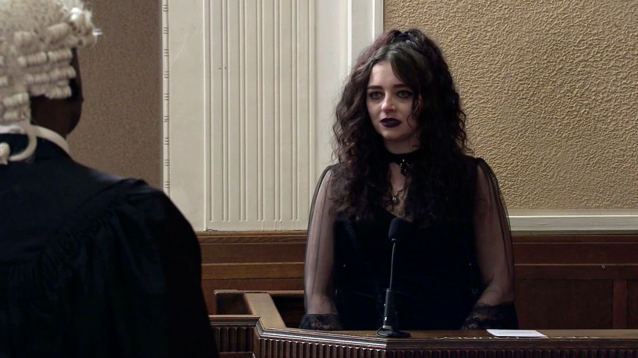 Nina Lucas [Mollie Gallagher ] tells the court how she remembers seeing Corey kicking Seb repeatedly and Kelly begging him to stop
