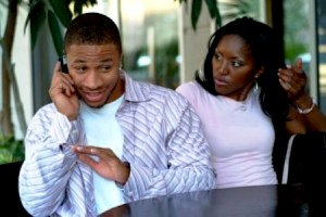 Black_couple_arguing_guy_on_Phone