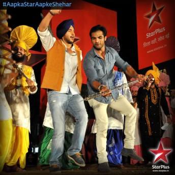 Ahem and Ranvijay doing a Bhangra dance on stage