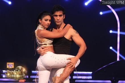 Kushal Punjabi posing with his partner Mohena