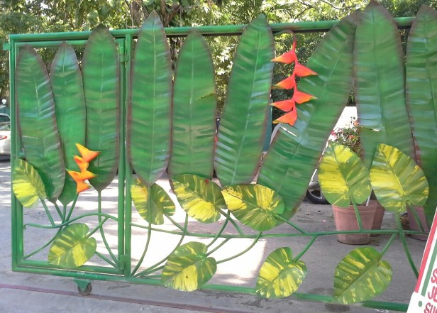 Iron gate with bird-of-paradise decoration